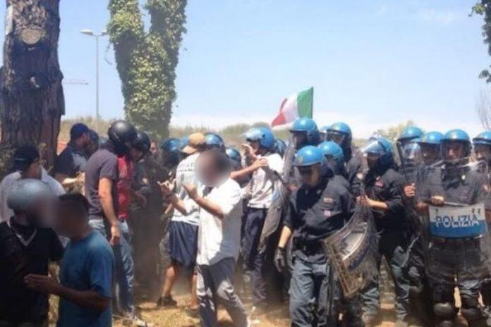 sassaiola contro poliziotti tendopoli san ferdinando